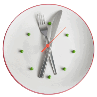 clock made using fork and knife on a plate